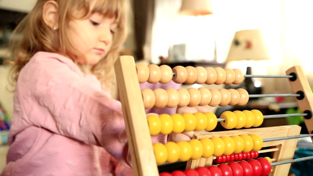 Cute little girl playing with abacus video
