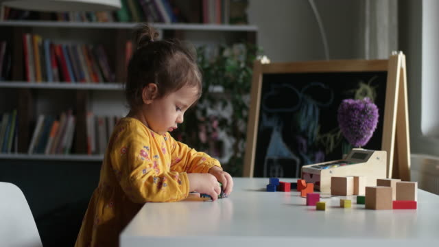 Cute little girl playing with wooden train Cute little girl playing with wooden train playroom stock videos & royalty-free footage