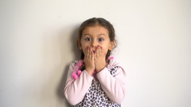 cute little girl surprised over gray background - sorpresa video stock e b–roll