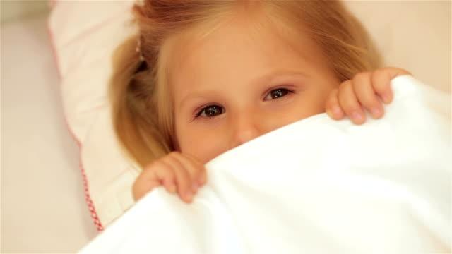 Cute little girl under the blanket video