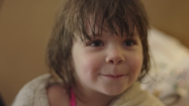 A cute little girl wrapped in a towel talking to somebody A cute little girl wrapped in a towel talking to somebody wearing a towel stock videos & royalty-free footage