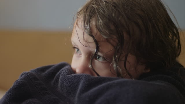 A cute little girl wrapped in a towel watching TV A cute little girl wrapped in a towel watching TV wearing a towel stock videos & royalty-free footage