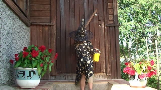 Cute little Halloween girl knocking in the door video