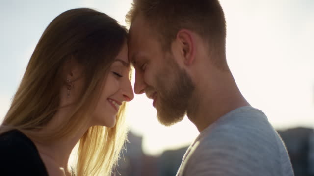 Cute Love couple standing nose to nose at sunset video