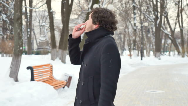 Cute man sneezes and uses the nose spray in the park video