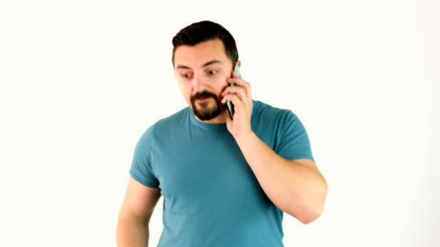 Cute man talking or having conversation with someone on his smart phone video