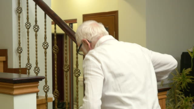 cute old man walks up the stairs at home - staircases stock videos & royalty-free footage