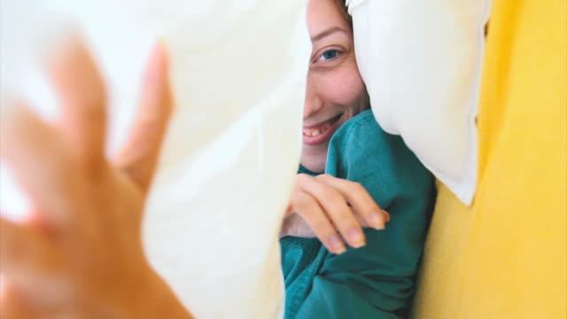 Cute playful girl under the sheet video
