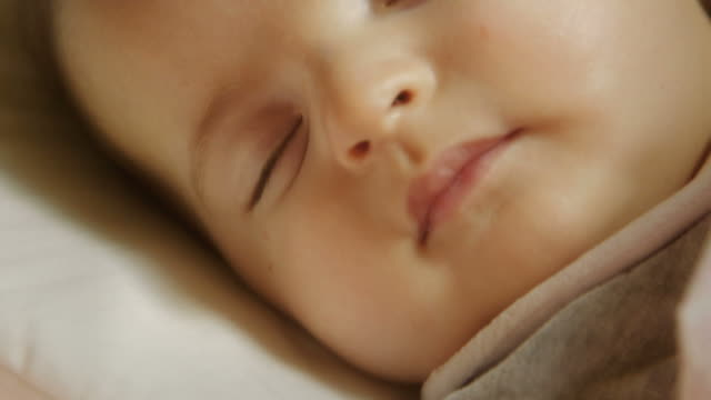 Cute quiet little female child napping in bed at home video