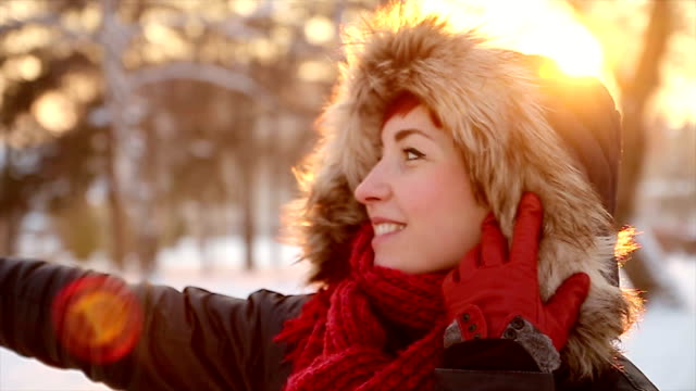 Cute red head woman enjoying in sunny winter day video