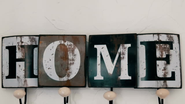 Cute stylish hanger on the wall of the house with cozy title video