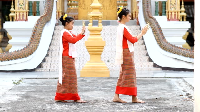 Cute Thai girls dancing at temple video