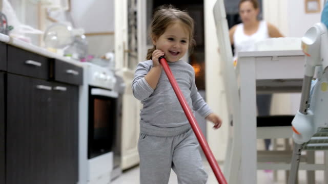 Cute toddler cleaning the kitchen video