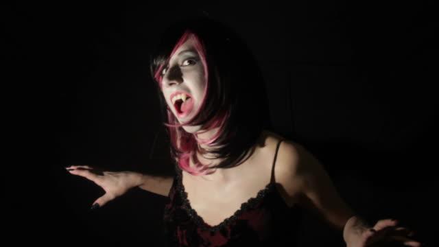 Cute Vampire Girl Rises Snarls Drifts Away video