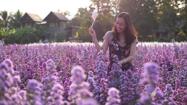 Cute woman happy in the field of purple Flower