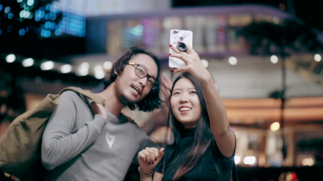 Cute woman selfie while traveling in the city Thailand, Bangkok, couple, two people, love, candid, portrait, smiling, Beautiful woman, Korean ethnicity, Japanese ethnicity, photographing, looking at camera, travel, city life, connections, technology, lifestyles, nightlife, tourist, portrait, hipster, travel, tourist, outdoors romance stock videos & royalty-free footage
