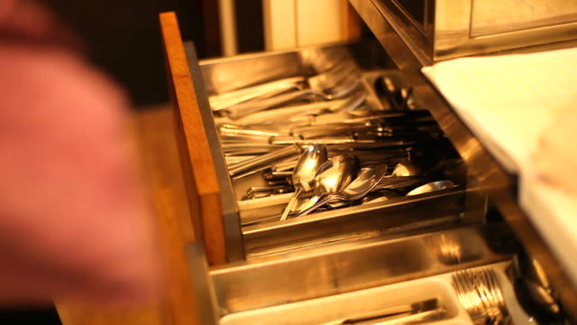 Cutlery put in drawer video
