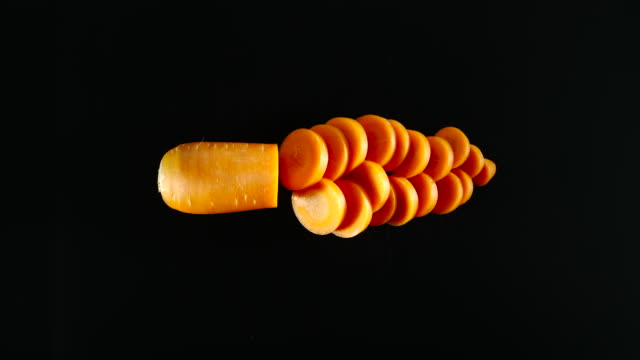 STOP MOTION: Cutting A Fresh Carrot On A Black Surface video
