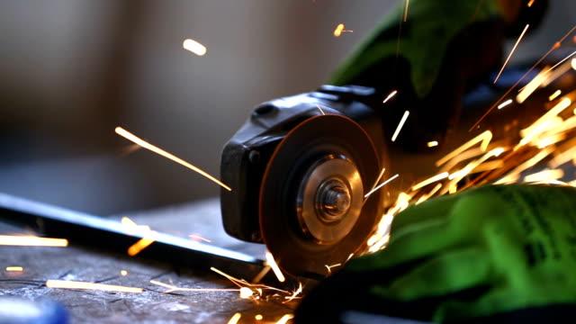 cutting a metal bar with a grinder. - spranga video stock e b–roll