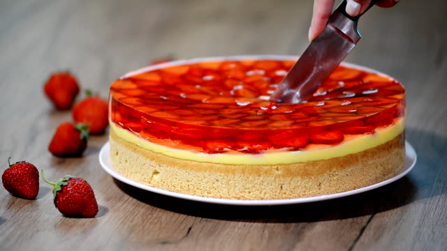 Cutting a piece of strawberry cake with jelly. Cutting a piece of strawberry cake with jelly jello stock videos & royalty-free footage