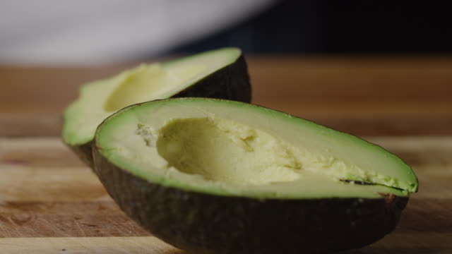 cutting and peeling avocado, cooking avocado toast - pane tostato video stock e b–roll