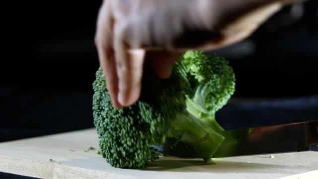 Cutting Broccoli on a cutting board video