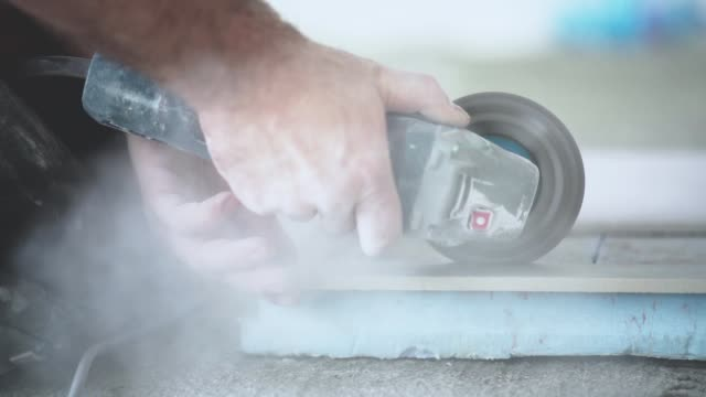 Cutting ceramic tile on slow motion footage