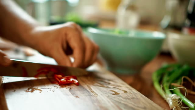 Cutting Chilies on a Cutting Board for Nasi Goreng video