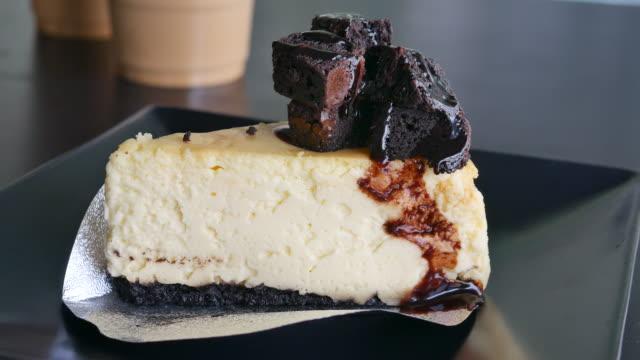 cutting chocolate cake in a cafe video
