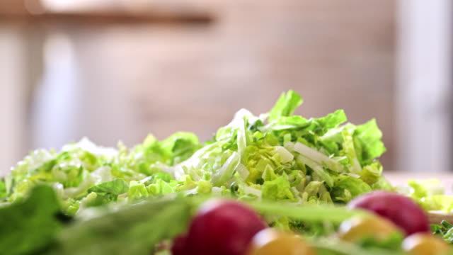 Cutting Fresh Green Salad for Preparing Salad Cutting fresh green salad for preparing delicous fresh salad paprika stock videos & royalty-free footage