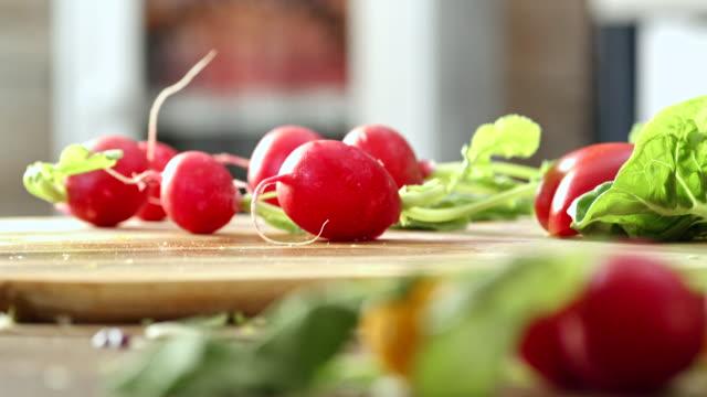 Cutting Fresh Radishes for Preparing Salad Cutting fresh radishes for preparing delicous fresh salad paprika stock videos & royalty-free footage