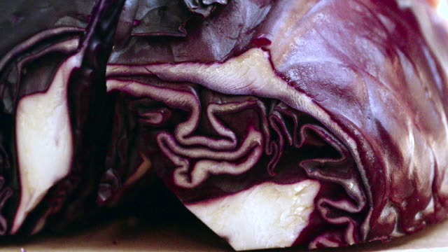 Cutting Fresh Red Cabbage for Preparing Salad Cutting fresh red cabbage for preparing delicous fresh salad paprika stock videos & royalty-free footage