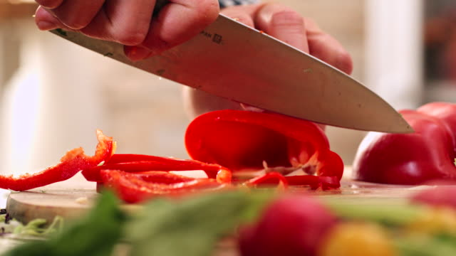 Cutting Fresh Red Paprika for Preparing Salad Cutting fresh red paprika for preparing delicous fresh salad celery stock videos & royalty-free footage