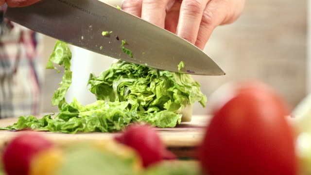 Cutting Fresh Vegetables for Preparing Salad Cutting fresh vegetables for preparing delicous fresh salad cabbage stock videos & royalty-free footage