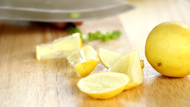 cutting lemon on board video