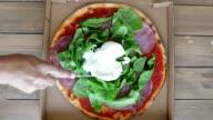 istock Cutting mozzarella on salami arugula pizza 1279485933