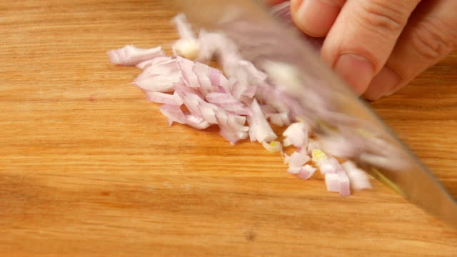 Cutting onions on the table. – Video