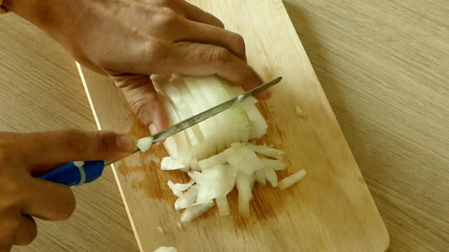 Cutting onions Close-up shot of hand cutting onions. onion stock videos & royalty-free footage