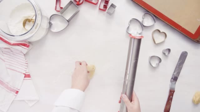 Cutting out shapes from sugar cookie dough Flat lay. Step by step. Cutting out shapes from sugar cookie dough with cookie cutters. cookie cutter stock videos & royalty-free footage