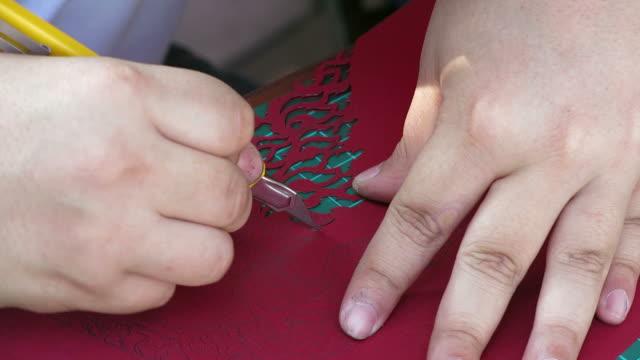 Cutting paper in Thai pattern video