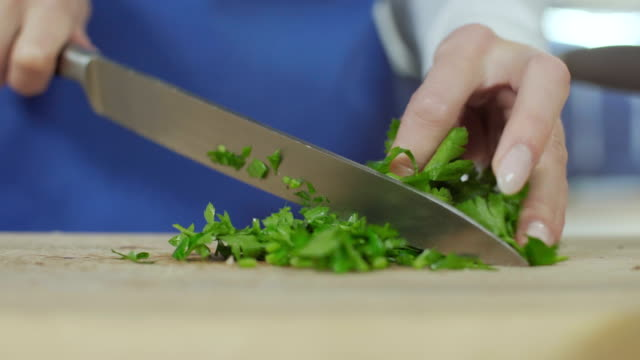 Cutting parsley Cutting parsley parsley stock videos & royalty-free footage