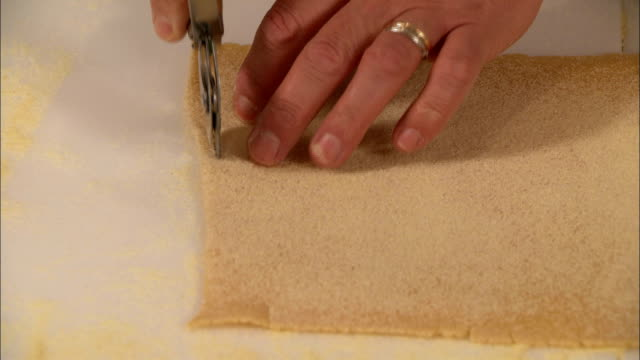 Cutting Pasta Chef cuts pasta slices. Close-up. uncooked pasta stock videos & royalty-free footage