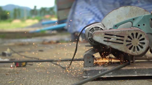 Cutting rebar slow motion video