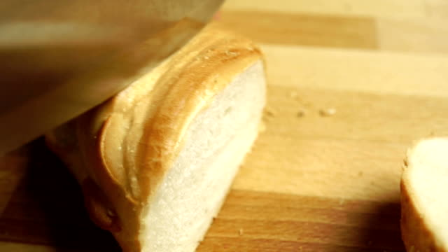 Cutting soft wheat bread, close up video video