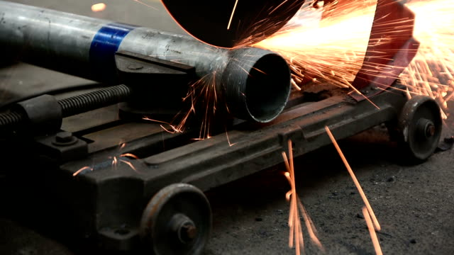 Cutting steel. worker Cutting steel. pipe connector stock videos & royalty-free footage