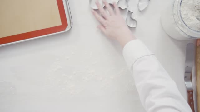 Cutting sugar cookie dough with Easter shaped cookie cutters. Step by step. Flat lay. Cutting sugar cookie dough with Easter shaped cookie cutters. cookie cutter stock videos & royalty-free footage