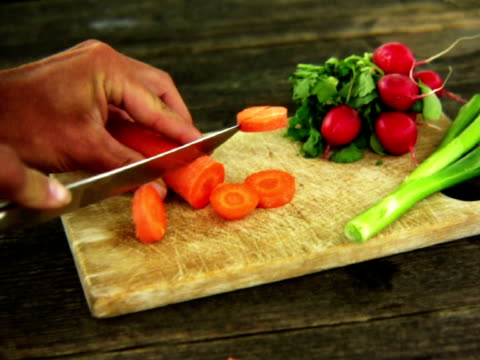 PAL:  Cutting the carrot Carrot cutted by a knife. flowering plant stock videos & royalty-free footage