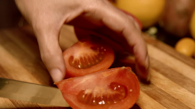 Cutting Tomatoes Into Parts video