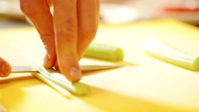 cutting vegetables in kitchen video