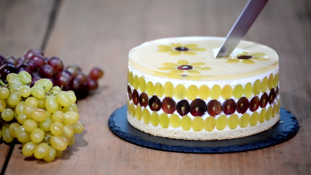 Cutting with a knife mousse cake with grapes. Round mousse cake decorated with grapes. Cutting with a knife mousse cake with grapes. Round mousse cake decorated with grapes. jello stock videos & royalty-free footage
